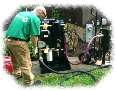 Photograph of a Greentech employee using a fuel cleaning machine.